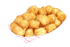 Tater Tots. Fried tater tots in basket.  Isolated on white background Royalty Free Stock Images