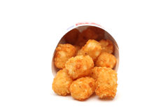 Tater Tots. In a containter on a white background Royalty Free Stock Image