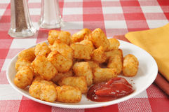 Tater tots. A plate of deep fried tater tots with catsup Stock Photo