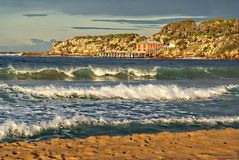 Tathra Wharf. Is a popular tourist attraction on the New South Wales Coast of Australia. The Wharf is very old and recently was battered by the cyclone off royalty free stock photography