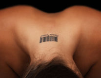 Tatoo on a female neck Royalty Free Stock Image