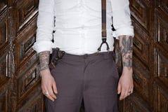Tatoo macho man posing. Alternative underground aggressive tattooed body art detail fashion Stock Image