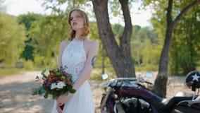 Tatooed bride pose to photographer. stock video footage