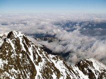Tatra mountains. Aerial view of High Tatra mountains in winter above cloudscape, Slovakia Royalty Free Stock Image