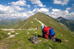 Tatra Mountains. Trekking shoes, rucksack and beautiful view of Tatra Mountains royalty free stock photos