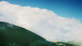 Tatra Mountains: Clouds over the tops with blue sky stock video