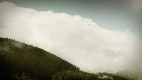 Tatra Mountains: Clouds over the tops with blue sky. 