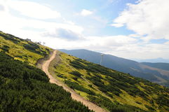 Tatra mountains landscape panorama with green grass and white clouds. Slovakia national park. Tatra mountains landscape panorama with green grass and white Royalty Free Stock Photography