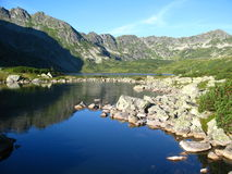 Tatra mountains in Poland, green hill, valley and rocky peak in the sunny day with clear blue sky Stock Images