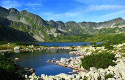 Tatra mountains in Poland, blue lake, sunny day with clear sky Stock Photography