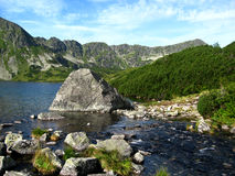 Tatra mountains in Poland, green hill, valley and rocky peak in the sunny day with clear blue sky Stock Photo