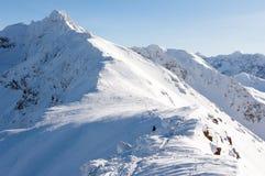 Tatra mountains in winter and a man. Tatra Mountains in the winter and the man on the slopes Royalty Free Stock Photos