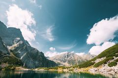 Tatra National Park, Poland. Calm Lake Czarny Staw under Rysy An. D Summer Mountains Landscape. Beautiful Nature, Scenic View Of Five Lakes Valley. UNESCO World stock photos