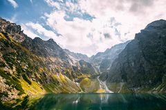 Tatra National Park, Poland. Calm Lake Czarny Staw Under Rysy And Summer Mountains Landscape. Beautiful Scenic View Of. Lake. UNESCO World Heritage Site. Polish stock images