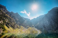 Tatra National Park, Poland. Calm Lake Czarny Staw Under Rysy And Summer Mountains Landscape. Sunshine With Sunrays. Above Beautiful Scenic View Of Lake. UNESCO stock image