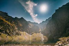 Tatra National Park, Poland. Calm Lake Czarny Staw Under Rysy And Summer Mountains Landscape. Sunshine With Sunrays. Above Beautiful Scenic View Of Lake. UNESCO royalty free stock photo
