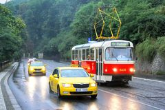 Tatra T3R and taxi cars Royalty Free Stock Image