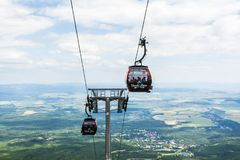 Gondola cable car transporting the family on a trip to the High Tatras. Royalty Free Stock Photos