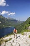 Tatras - Sea eye, Girl climbing royalty free stock photography
