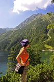Tatras - Sea eye, Girl looking at a mountain Stock Photography