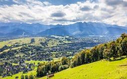 Tatry Mountains and Zakopane city surroundings stock photos