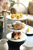 Tats and cake. A tea time serve with tats, scone and cakes Stock Photo