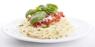 Tatsty fresh spaghetti tomato sauce and parmesan Royalty Free Stock Photography