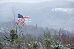 Tattered American flag blowing in the winter wind, Rangeley, Mai Stock Image