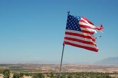 Tattered amerikanische Flagge Stockfotos