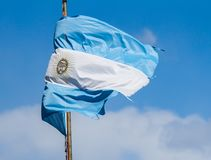 Tattered Argentina flag after battling rough winter Stock Photo