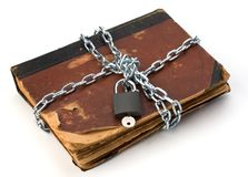 Tattered book with chain and padlock Stock Photo