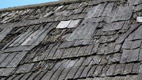 Tattered old broken cedar wooden shake shingle roof of the house stock video