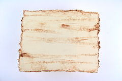 Tattered Paper. Tattered grunge paper on white stock photography
