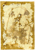 Tattered  paper. Brown stained tattered textured paper Royalty Free Stock Image