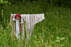 Tattered Rags. Old tattered Rags on Clothesline Stock Photos