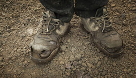 Tattered shoes feet Royalty Free Stock Images
