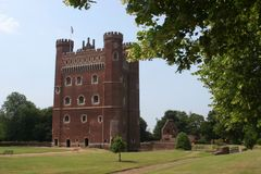 Tattershall Castle. Lincolnshire. The great red brick tower at Tattershall reaches a height of 30.5 metres (100ft) and is a prominent feature in the local Royalty Free Stock Photo