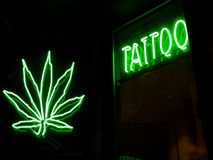 Tatto and marijuana neon signs Stock Image