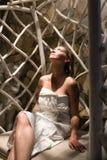 Girl in towel relaxing in tapidarium stock image