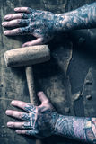 Tattoed hands Stock Images