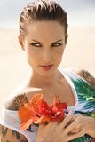 Tattoed woman with flowers. Royalty Free Stock Photos