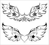 Tattoo. Tatto - wings with floral pattern and stars Royalty Free Stock Photography
