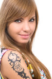 Tattoo. Attractive woman with tattoo on hand Stock Image