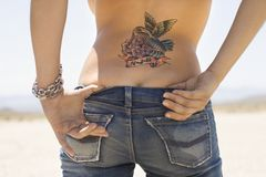 Tattoo And Derriere. Stock Images
