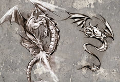 Tattoo art illustration, dragons over grey wall Stock Photo