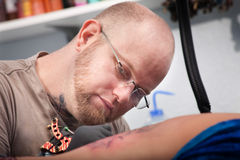 Tattoo Artist Stock Photo