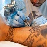 Tattoo artist Stock Image