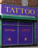 Tattoo Artist Belfast. A tattoo parlour in Belfast City Centre advertising Tattoo Artist in Northern Ireland Stock Photography