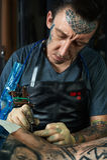 Tattoo artist draw a tattoo Stock Photo