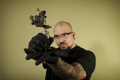 Tattoo artist holding his machine Stock Photography
